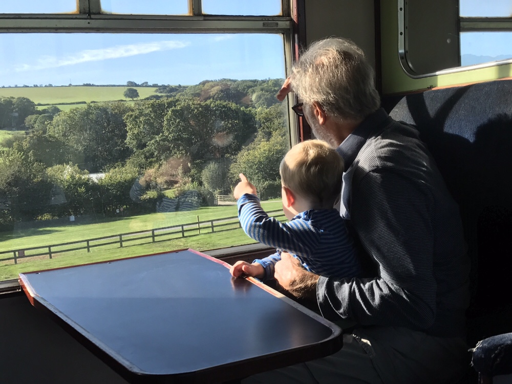 A toddler and grandad on Swanage Steam Railway